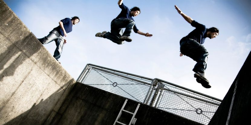 Adolescents performing parkour
