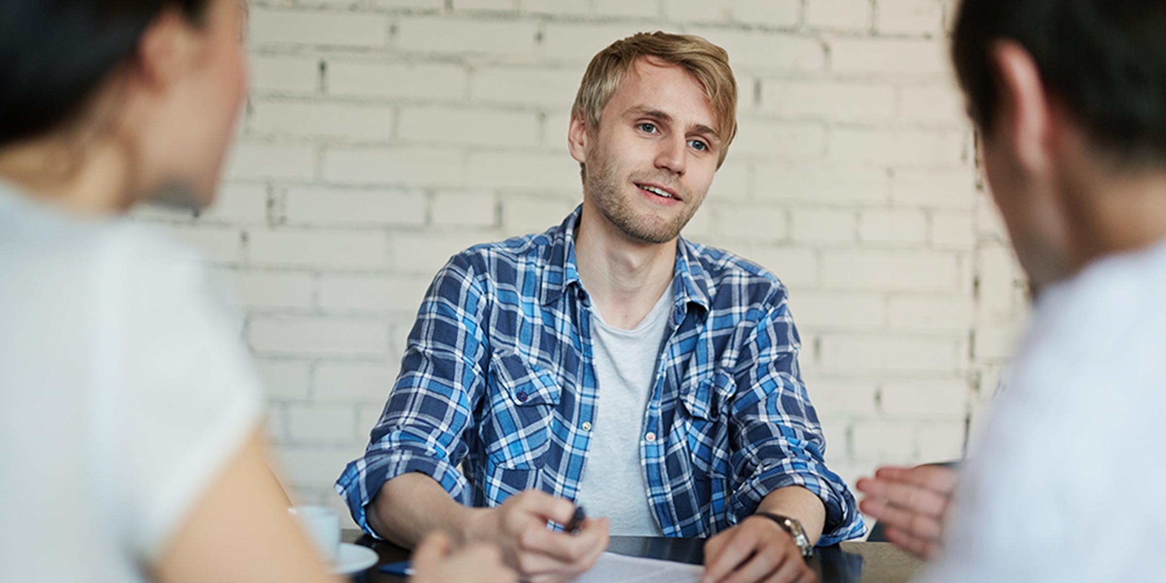 A young man at a job interview